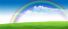 蓝天彩虹绿地背景