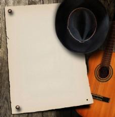 吉他帽子空白纸背景图片