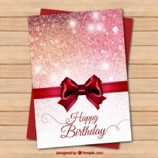鲜红的生日贺卡与弓