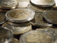 堆在一起的硬币图片