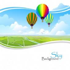 波状边缘草坪上的热气球