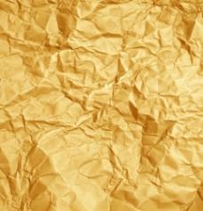 金色皱巴巴的纸张背景图片